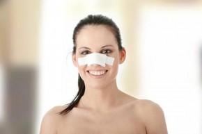 Young beautiful woman face after nose surgery