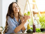 Woman with green healthy food and drinks at home